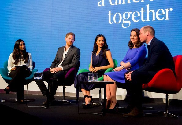 Meghan Markle wore Jason Wu Flared Belted Satin Dress. Kate Middleton wore Seraphine Royal Blue Tailored Maternity Dress. Prince Harry