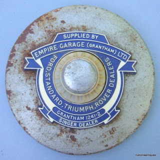 Empire Garage (Grantham) Ltd metal tax disc holder