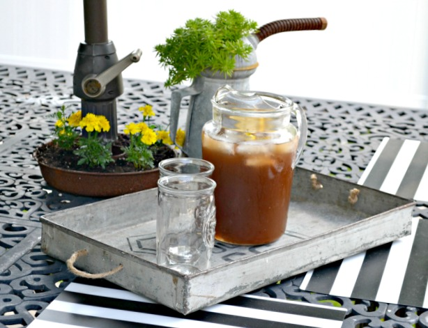 Tray filled with iced tea glasses and pitcher