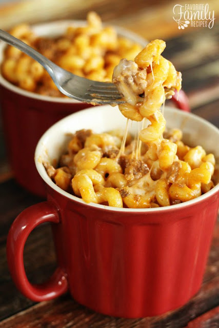 cheesy pasta and ground beef dinner served in red mug