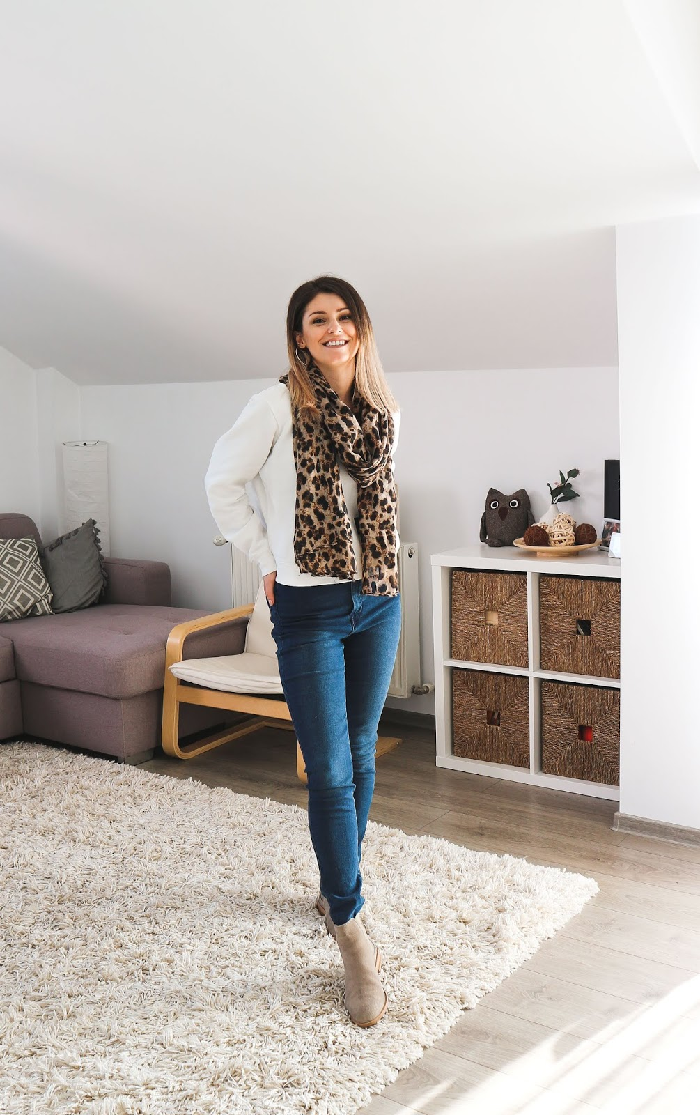 leopard print outfit with scarf and jeans