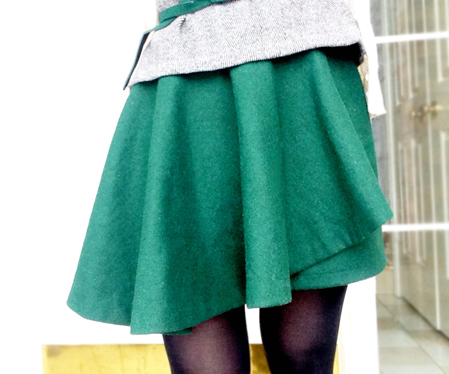 Tweed peplum top and green assymetric skirt