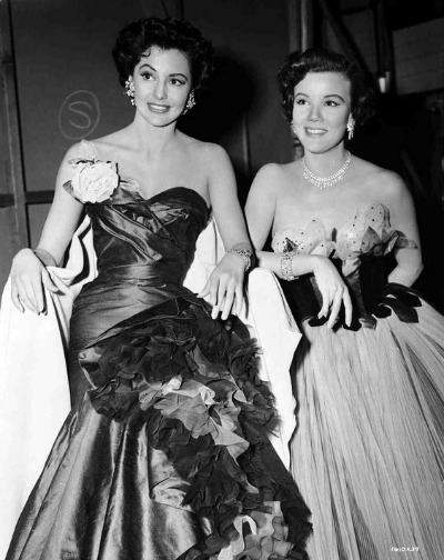 "Cyd Charisse as Gabrielle Gerard backstage with Nanette Fabray  as Lily Marton wearing formals backstage in 1953 ""The Band Wagon"""