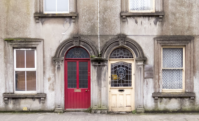 Red and white doors in Youghal, County Cork spotted on an Irish road trip between Dublin and Kinsale