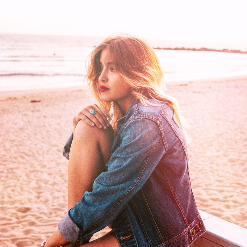 Bohemian whimsical beach style shot in gorgeous natural hike of fort funston in san francisco, marin, california on Bryn Newman by John Thatcher and urban outfitters understated leather collaboration jacket shot in venice beach california on bryn newman