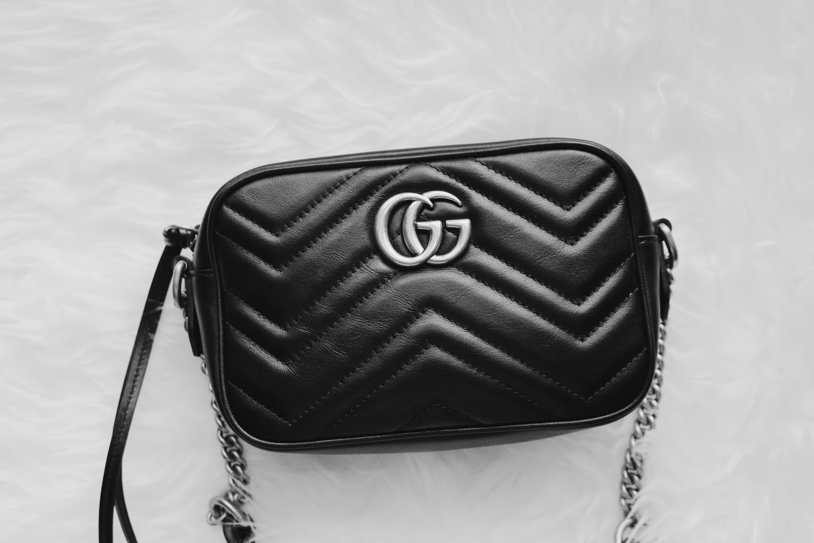 332bb4ffc1c37d A few months ago, I decided to purchase the Gucci GG Marmont Matelassé Mini  Bag. The bag retails at $980 which when deciding between this bag and the  Gucci ...