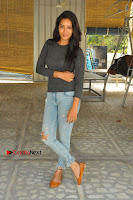 Actress Bhanu Tripathri Pos in Ripped Jeans at Iddari Madhya 18 Movie Pressmeet  0066.JPG