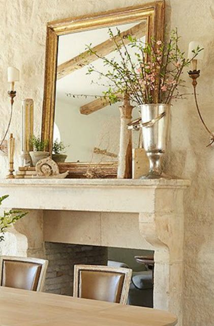 Limestone fireplace and hearth wall in #PatinaFarm dining room with #FrenchFarmhouse and #modernfarmhouse decor