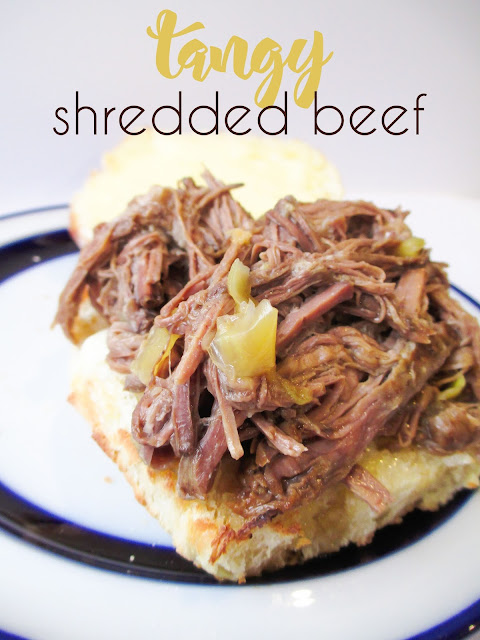 This easy crock pot tangy shredded beef tastes amazing and only has 3 ingredients!