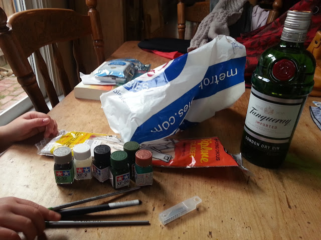 New modelling tools: paints, paintbrushes, scalpel blades.