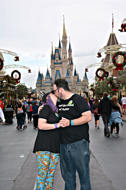 Celebrating my Birthday at the Magic Kingdom - Couple Kissing in front of Cinderella's Castle