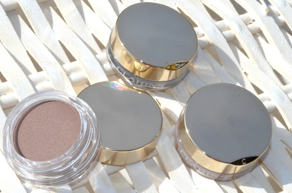 Close up of the eyeshadow jars with their gold metallic lids
