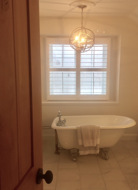 image result for knotty alder door Pacific Entries in master bathroom with clawfoot tub