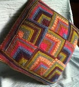 http://www.ravelry.com/patterns/library/colourful-cushion-cover