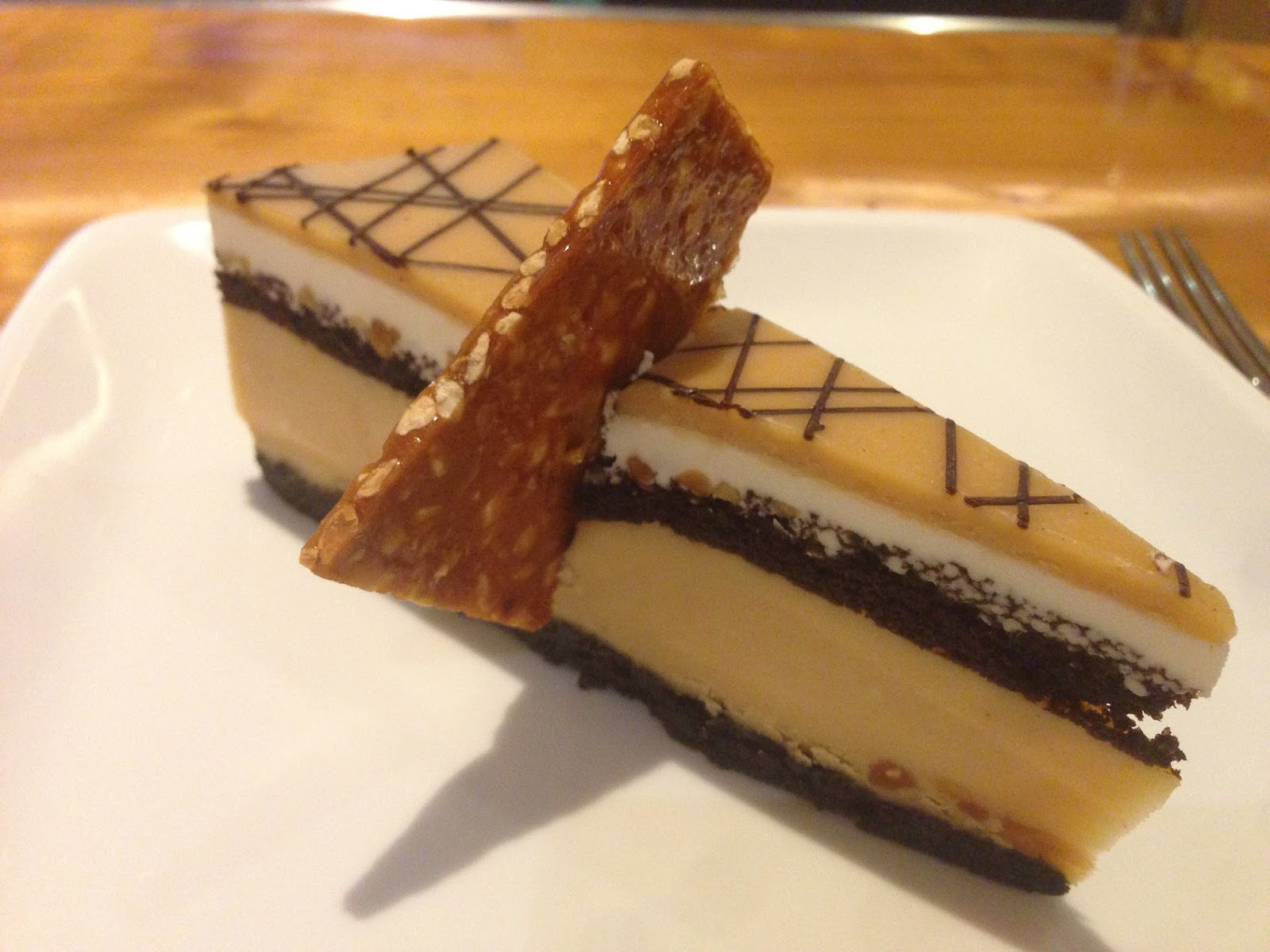 Peanut Butter Cheesecake. With peanut brittle. Pretty high on the ...