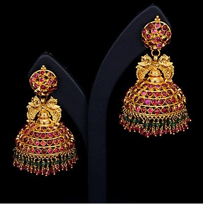3810b6e4e Content for earrings : These are the gold jhumkas. these are beautifully  designed by red stones with a jhumka. And two peacoks were there at top.the  ear ...