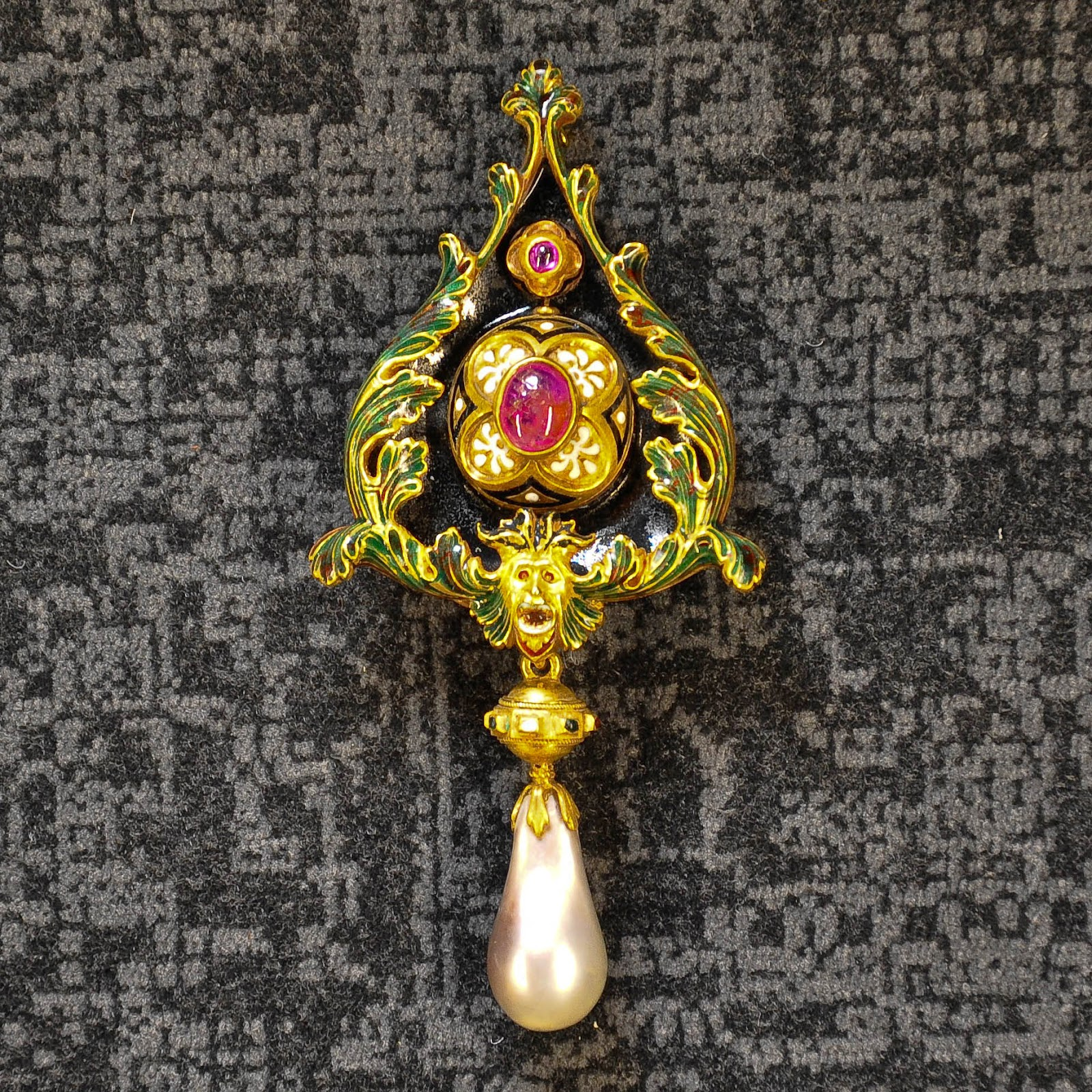 A brooch from the second half of the 19th century with ruby, enamel. gold and grey pearl in the Museum of the Jewellery in Vicenza