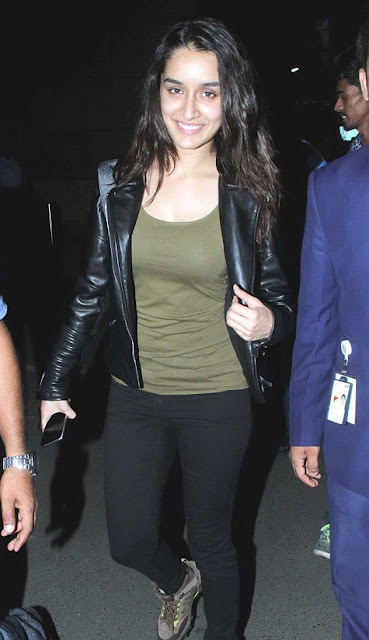 Wear your leather topper with a khaki green top and black pants