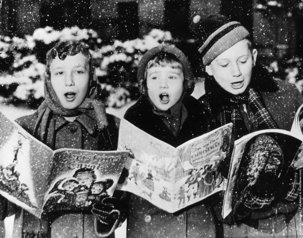 Three young carol singers give their rendering of a christmas song in the falling snow 1955 photo by keystone getty images