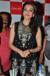 Kajal Aggarwal in lovely Black Sleeveless Anarlaki Dress in Hyderabad at Launch of Bahar Cafe at Madinaguda 015.JPG