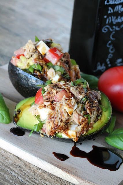 Caprese Stuffed Avocados have all the flavors of caprese you love stuffed into an avocado. It's an easy and healthy lunch that will quickly become one of your favorites.