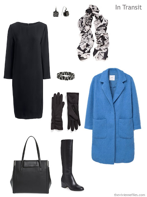 a travel outfit of a black dress with black accessories and a blue coat