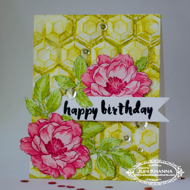 Floral stamped card with Altenew stamps. The background is embossed with We R memory keepers next generation embossing folder