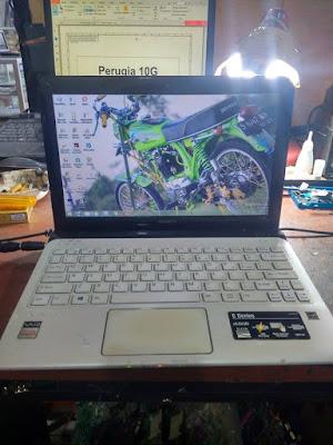 service engsel laptop malang