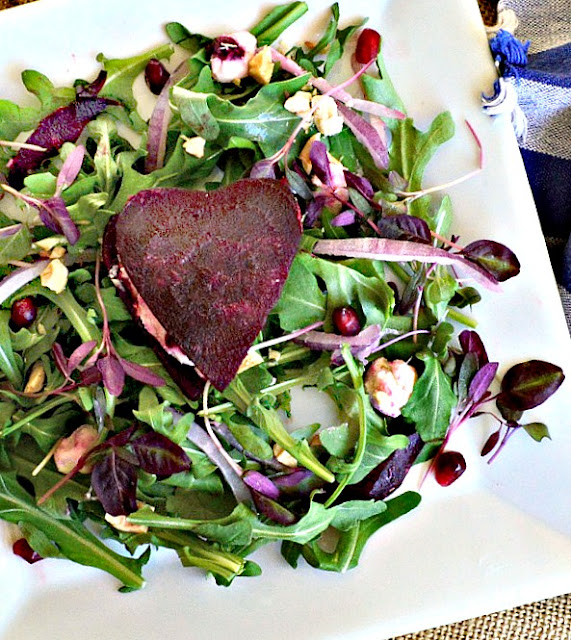 Baby Lettuce Salad with a Beet heart filled with goat cheese.