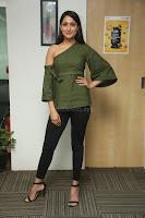 Pragya Jaiswal in a single Sleeves Off Shoulder Green Top Black Leggings promoting JJN Movie at Radio City 10.08.2017 063.JPG