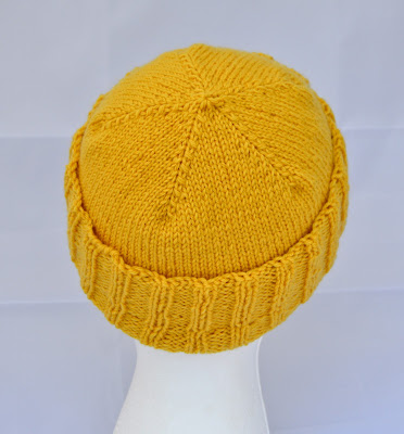 a hand knit hat for sale at https://www.etsy.com/shop/JeannieGrayKnits