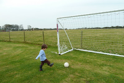 playing football at Croft Farm Cottages