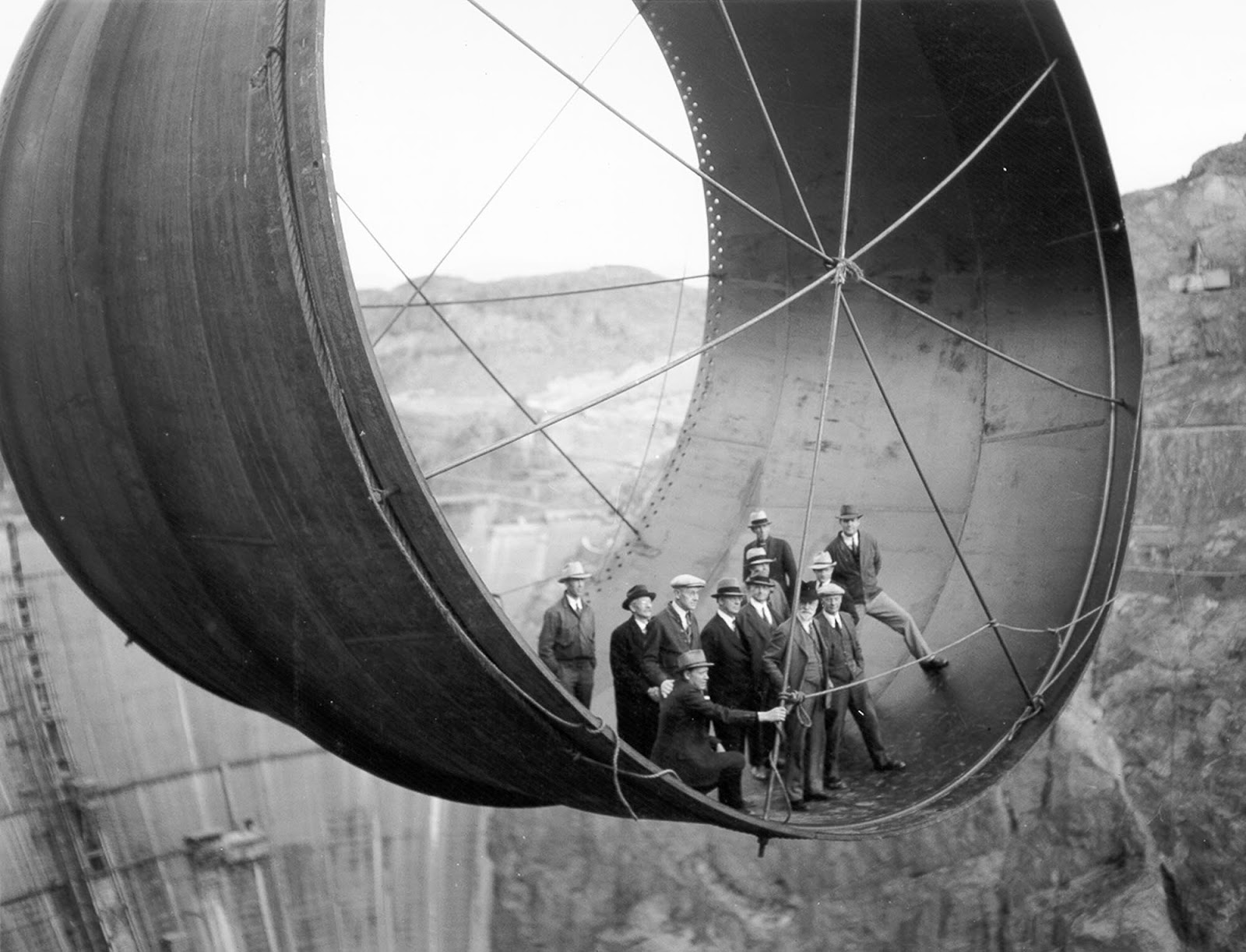 Men stand in a 45 ton steel pipe over the Hoover Dam.