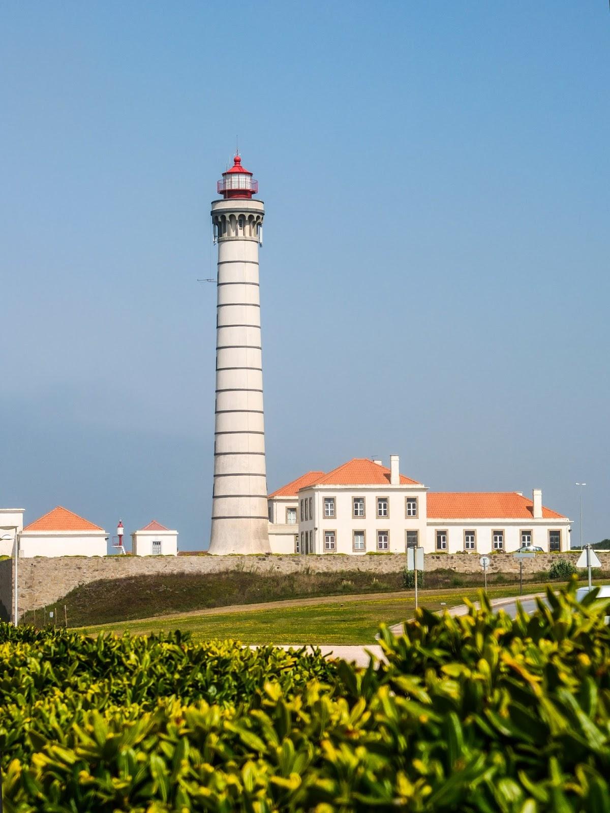 View over the hedge of the Leça Da Palmeira Lighthouse in Porto, Portugal.