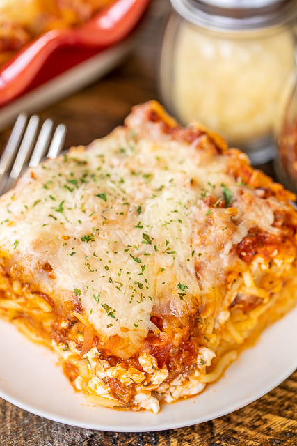 Favorite Baked Spaghetti - the most requested casserole in our house! Loaded with tons of yummy cheese!!! Spaghetti, Italian sausage, eggs, parmesan cheese, spaghetti sauce, tomato sauce, mozzarella cheese, and cottage cheese. Can make ahead and refrigerate or freeze for later. Great for parties, potlucks or homemade gifts. Serve with a salad and some garlic rolls for a meal better than any restaurant! #freezermeal #casserole #pasta #spaghetti