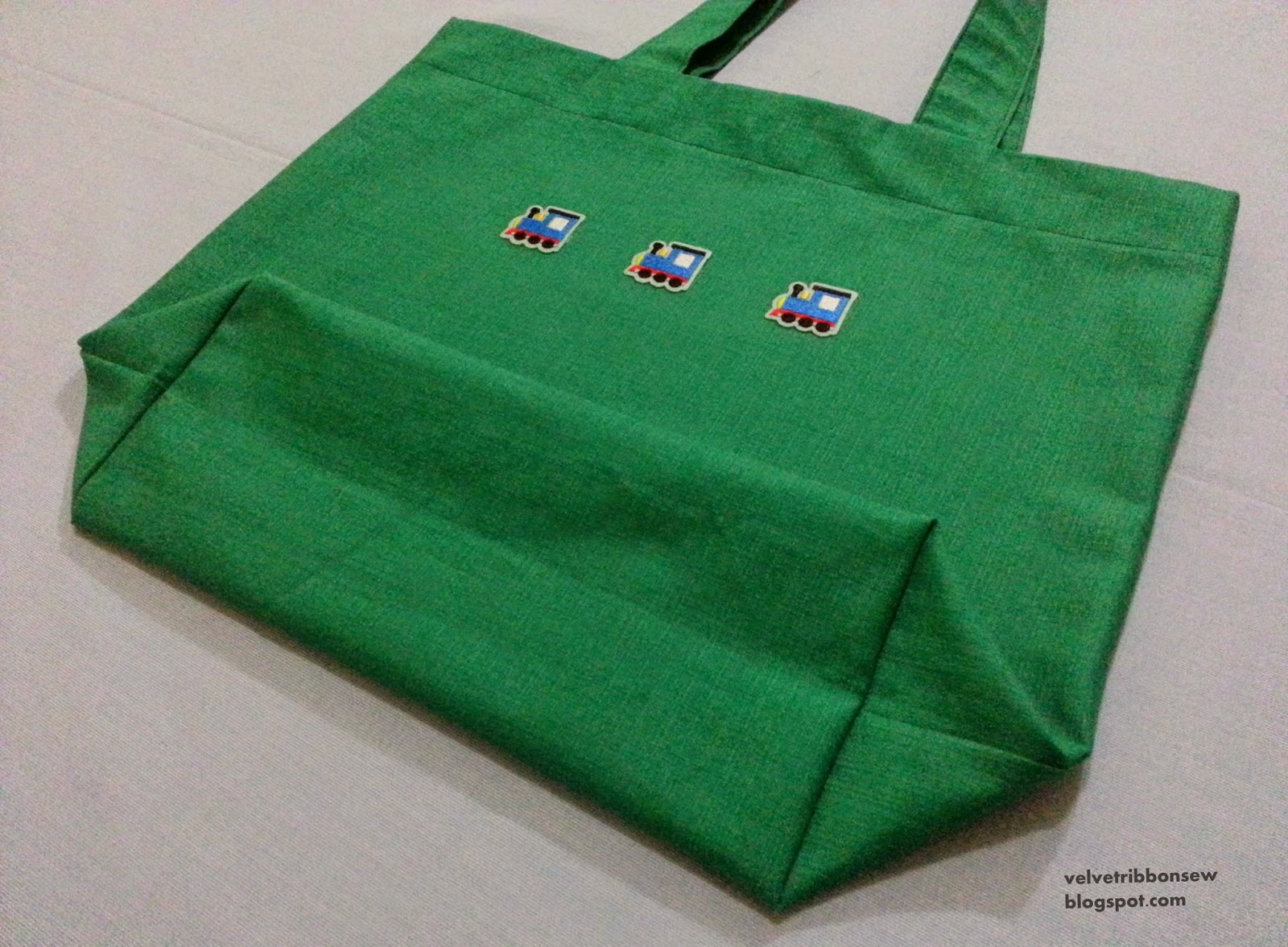 Green tote bag with trains
