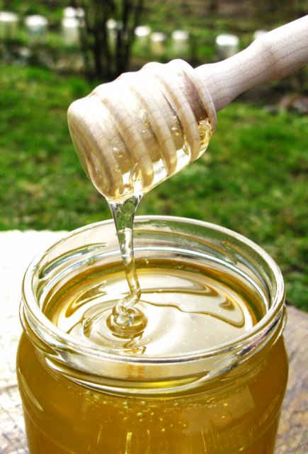 organic honey harvested in a glass container