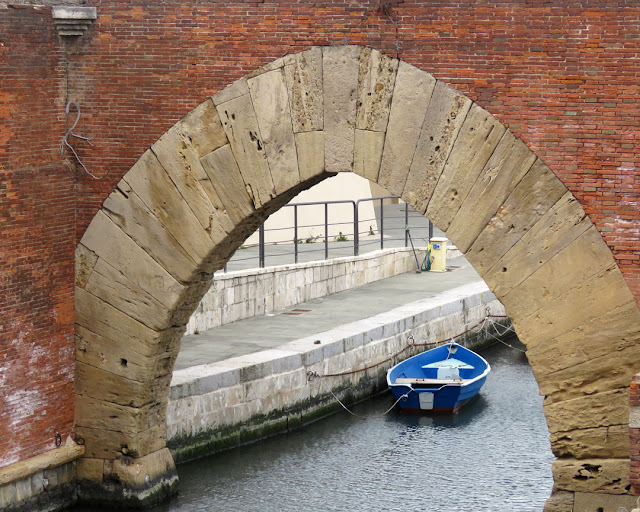 A boat seen through the arch of the old Dogana d'Acqua, Customs on the Water, Livorno