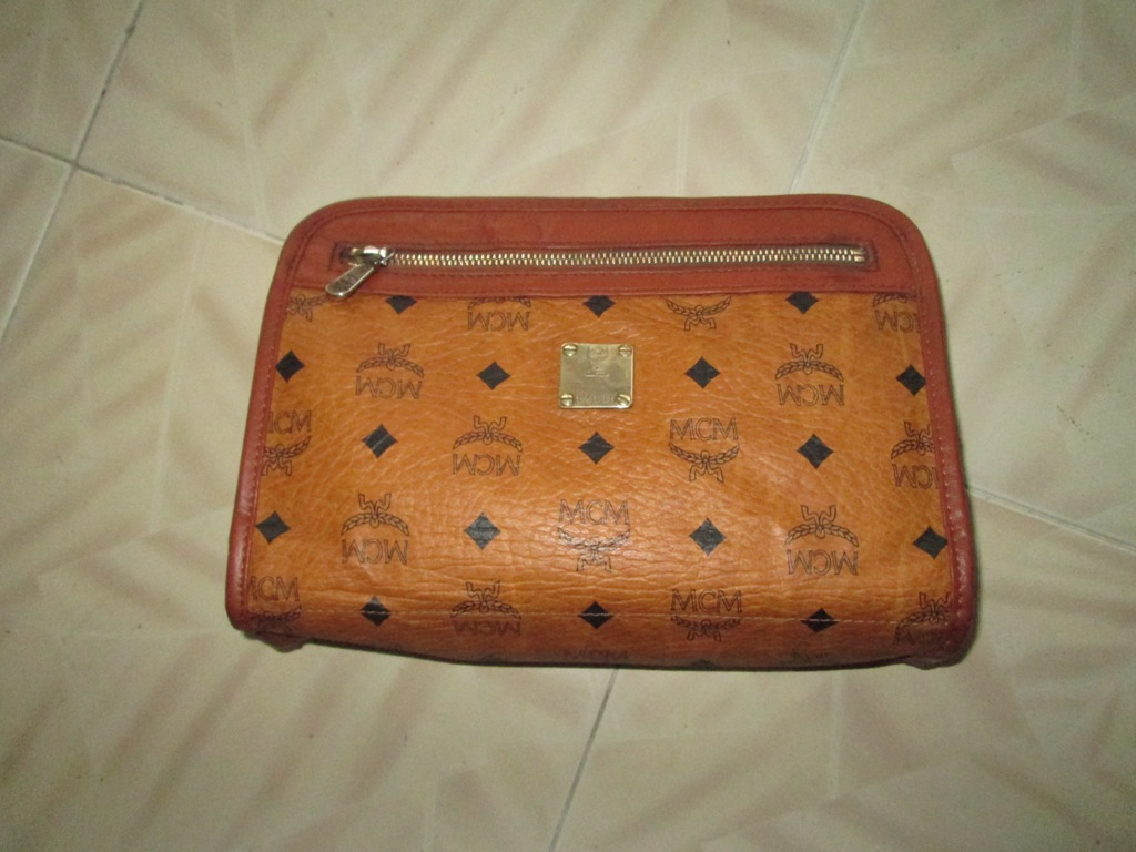 Authentic Mcm Monogram Leather Clutch