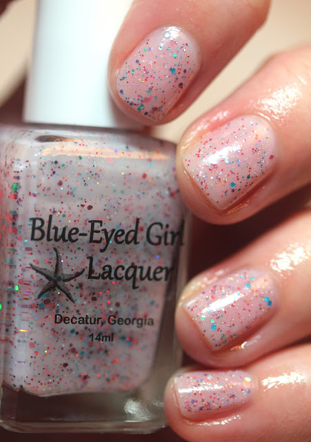 pink nail polish with blue and orange glitter