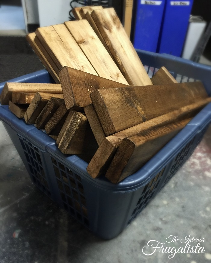 Rough fence boards cut to size and stained with Minwax Dark Walnut to make Rustic Wedding Centerpiece Trivets.