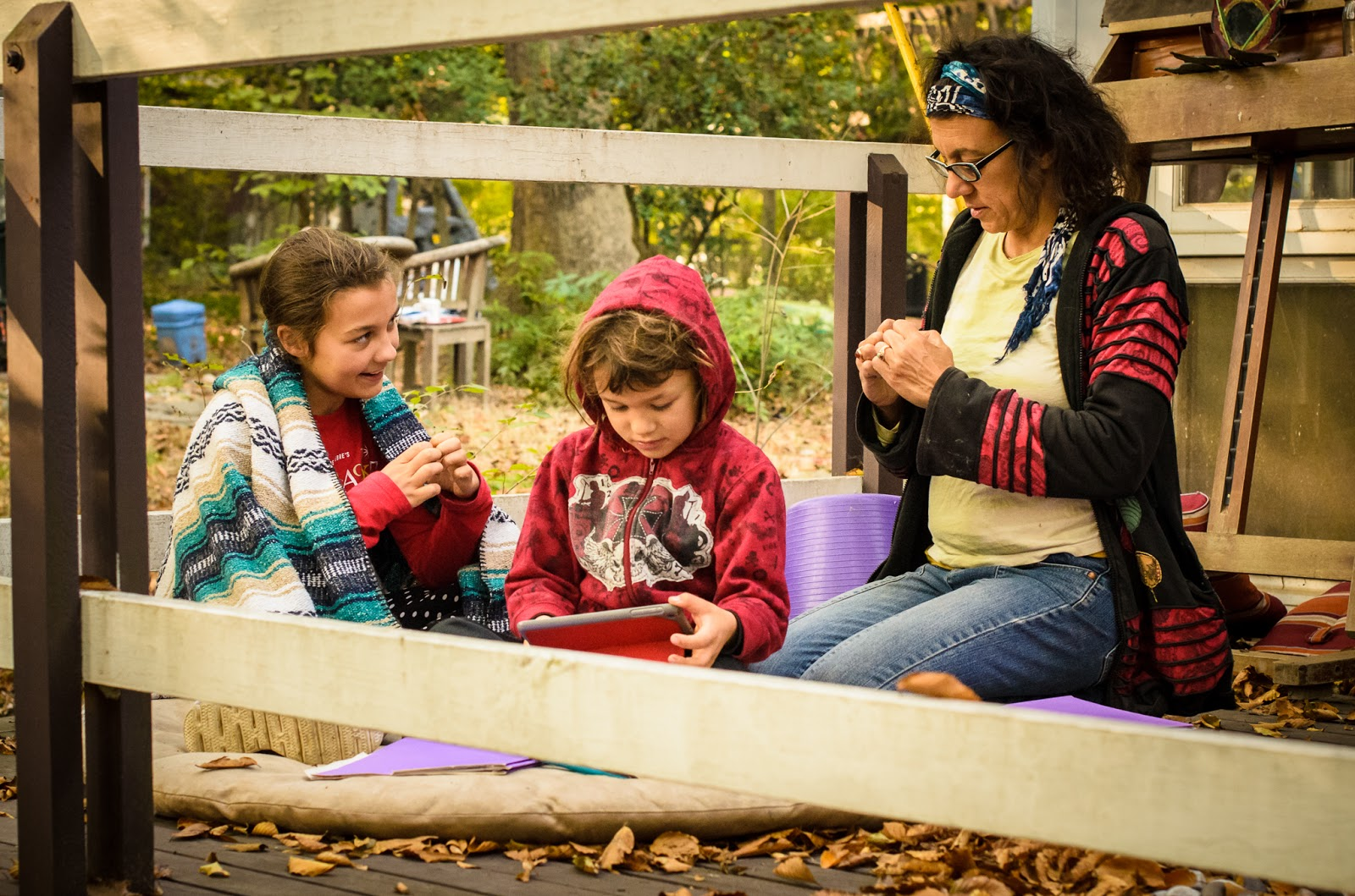 homeschooling family talking about lesson outside  ©Diana Sherblom Photography