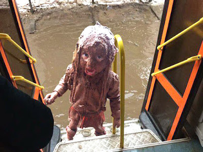 kid splashed by bus puddle