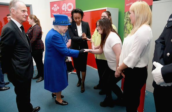 Queen Elizabeth II and Prince Charles, Prince of Wales visit the Prince's Trust Centre in Kennington