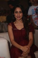 Pragya Jaiswal in Stunnign Deep neck Designer Maroon Dress at Nakshatram music launch ~ CelebesNext Celebrities Galleries 113.JPG