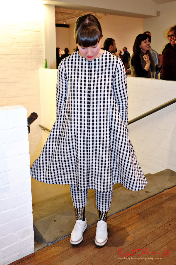 Alpha 60 matching gingham dress and pants with white plimsols seen at Roslyn Oxley9 gallery. Street Fashion Sydney.