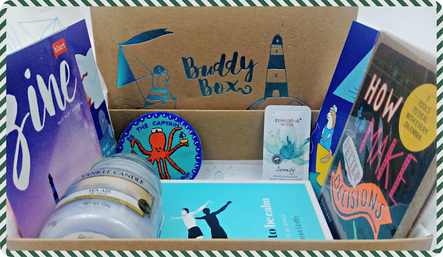 An open Buddy Box, showing contents from the May box.