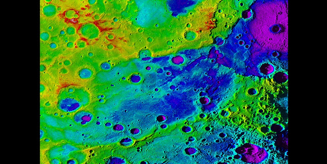 "Using colorized topography, Mercury's ""great valley"" (dark blue) and Rembrandt impact basin (purple, upper right) are revealed in this high-resolution digital elevation model merged with an image mosaic obtained by NASA's MESSENGER spacecraft. Credit: NASA/JHUAPL/Carnegie Institution of Washington/DLR/Smithsonian Institution"