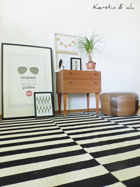 Dekoration Black and White mit Elefantenfuß und Art Prints