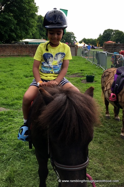 Riding a Shetland pony at Geronimo